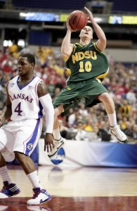 North Dakota State University's Ben Woodside soars past Kansas' Sherron Collins for a basket Friday during the NCAA tournament at the Metrodome in Minnepolis. David Samson/The Forum